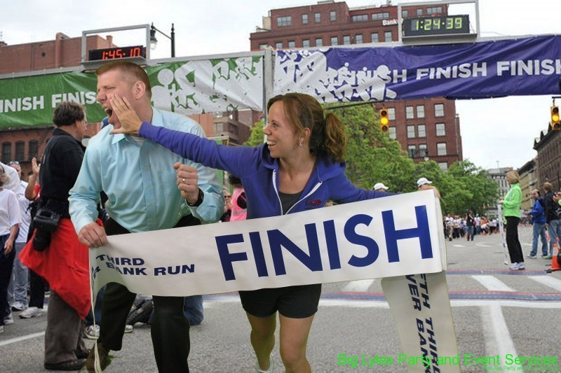 couple being funny pushing to be first  at 2014 Fifth Third River Bank Run in Grand Rapids MI