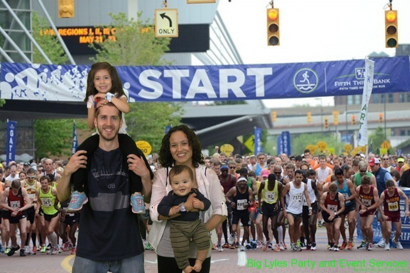 Mom and dad with  kids at the starting line  at 2014 Fifth Third River Bank Run in Grand Rapids MI