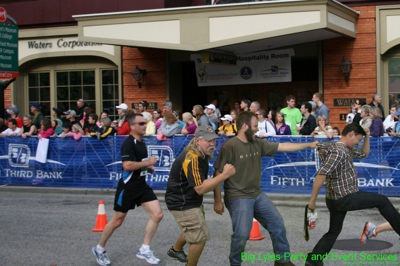 three funny men fighting to be in front  at 2014 Fifth Third River Bank Run in Grand Rapids MI