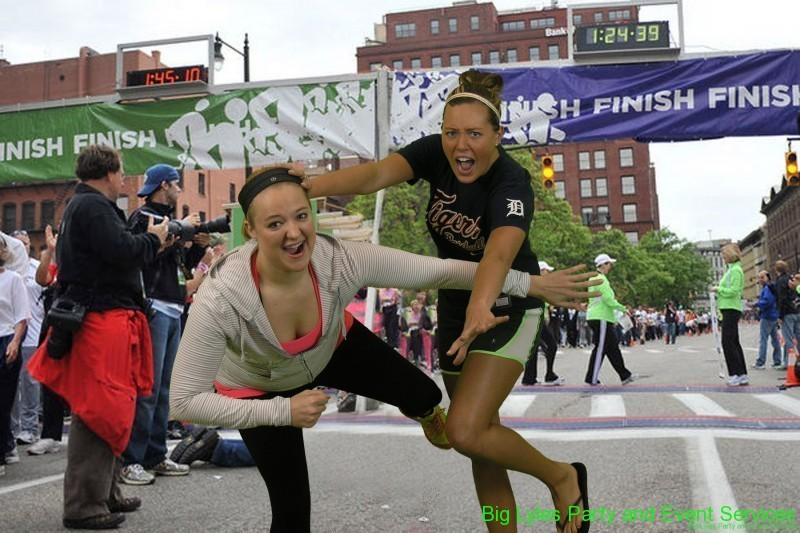 two girls fighting to be first across finish line  at 2014 Fifth Third River Bank Run in Grand Rapids MI