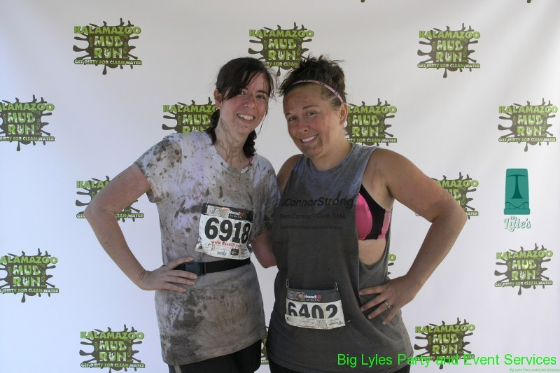 two moms dirty from mud 2014 Kalamazoo Mud Run Race