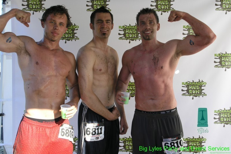 three shirtless runners from 2014 Kalamazoo Mud Run Race