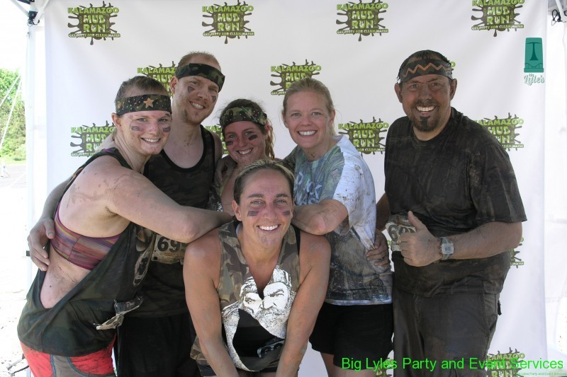 dirty bunch of runners at 2014 Kalamazoo Mud Run Race