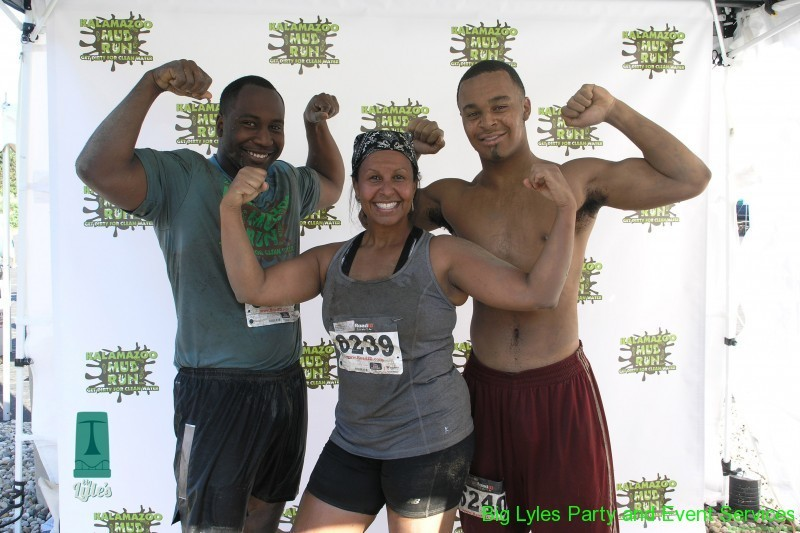 Three happy muddy runners at 2014 Kalamazoo Mud Run Race