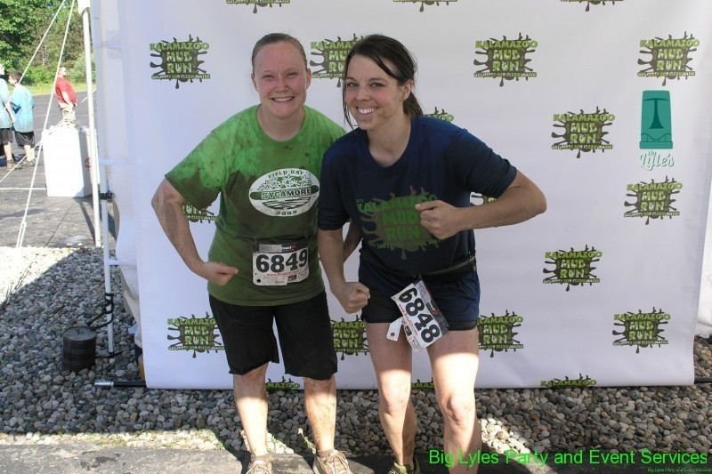 two muddy runners 2014 Kalamazoo Mud Run Race