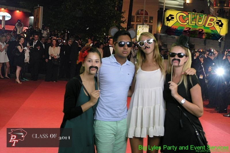 A group of teens on the red carpet with funny Mustaches