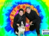 Event Goers Pose in front of a Funky Background with their Beloved Dog