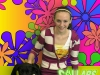 Girl Stops for a Photo with Her Dog in Front of a Funk-a-delic Background