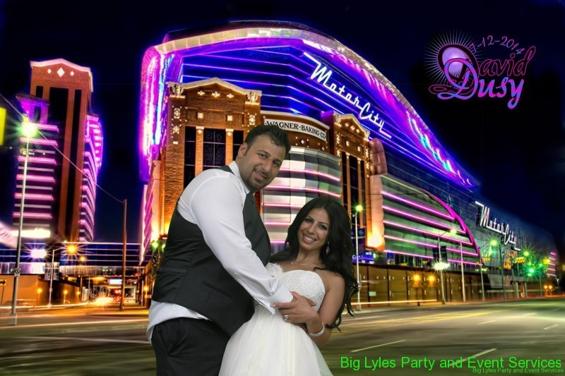 Bride and groom in front of Motor city casino