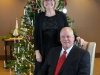 Couple poses for Christmas photo at Dominican Sister's charity event.
