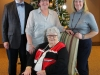 Family gathers together for a Christmas photo at Dominican Sister's charity Christmas party.