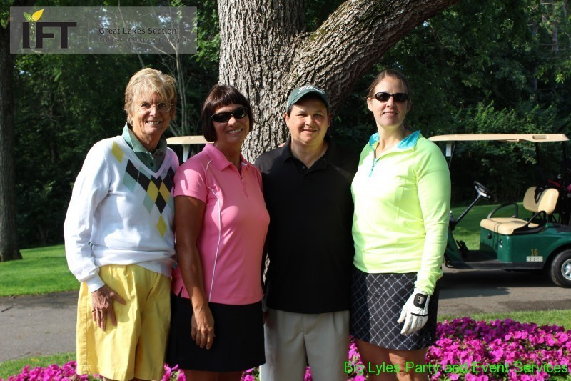Threesome at golf outing