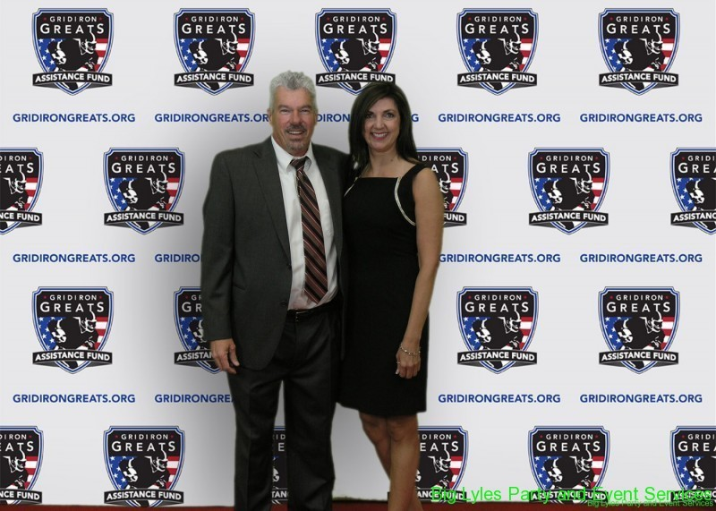 couple attending  on the Red Carpet at 2014 Detroit Gridiron greats event