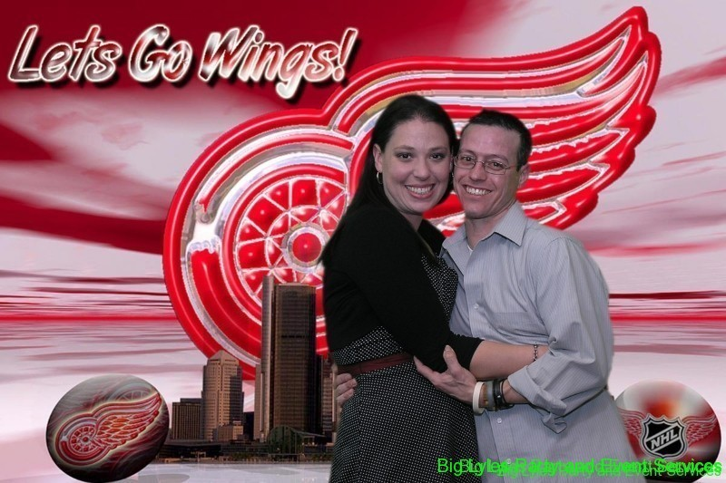 couple with Detroit Red wings sign