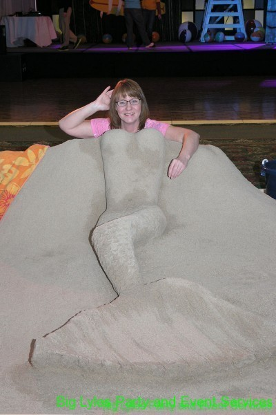 lady as a Sand Sculpture of mermaid, Fun photo op