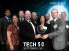 Group of people with award for technoligy