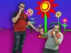 Southern Indiana University students creating event souvenirs at a green screen photo station