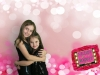 Sisters show some love on a cute valentine day background!