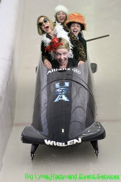 three girls in a Bobsled