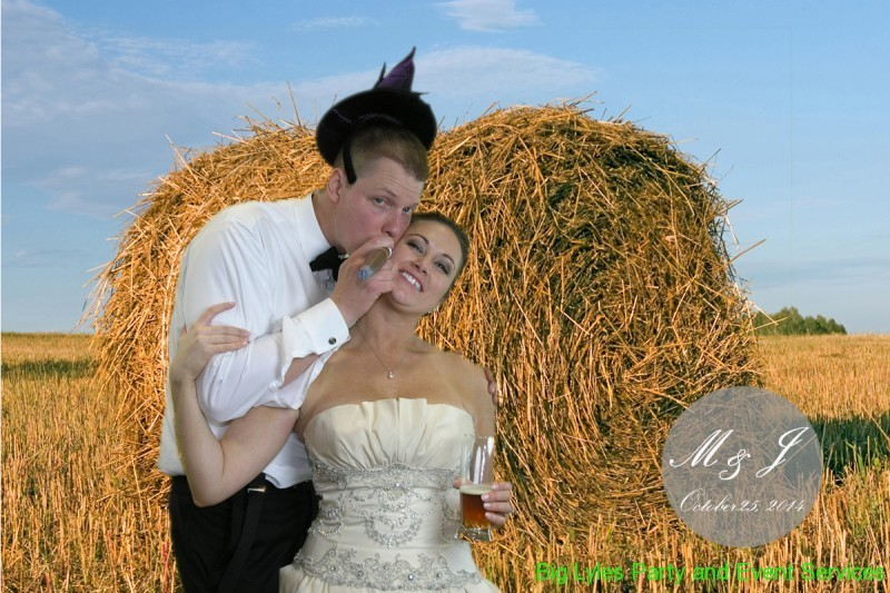 bride and groom with a big bale of hay