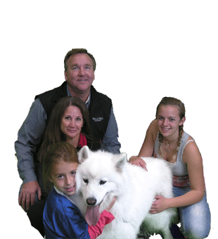Family with beautiful white dog