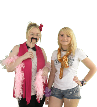 two girl with boa and props