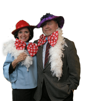 Fun couple with boas and hats