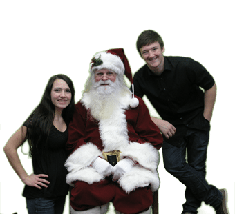 Cute young couple in photo with Santa