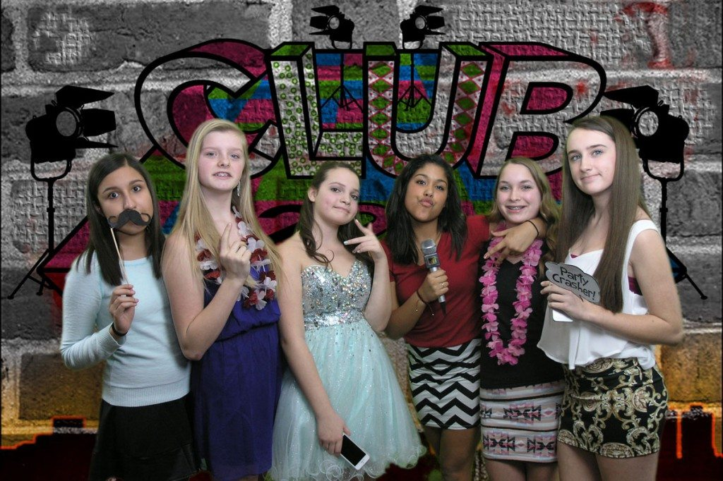 Group of teens with photo props