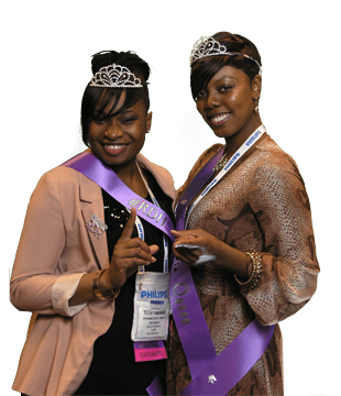 two black women in crowns