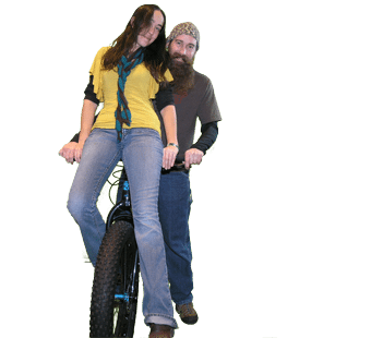 Man riding girl on handle bars