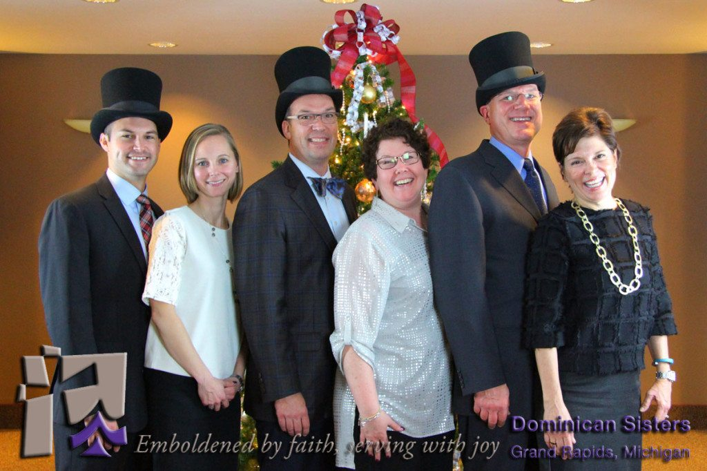 Three men in top hats with wifes.